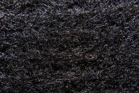 Detail of carbon fiber weave (carbon filter). Фото со стока