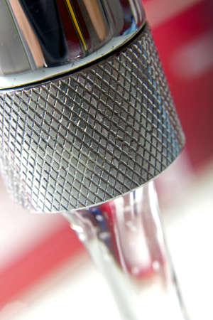 watertap: faucet with water, macro Stock Photo