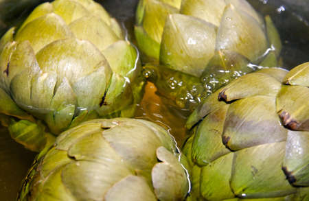 coocing: Closeup and detailed shots of fresh boiling  artichokes  Stock Photo