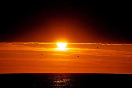 Beautiful sunset on the beach, Atlantic ocean photo