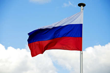 Russia flag with clipping path aganst the  blue sky