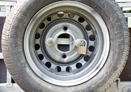 car theft: Car wheel lock to prevent theft Stock Photo