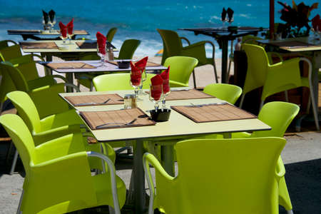 Tables at seaside restaurant with beautiful view Фото со стока