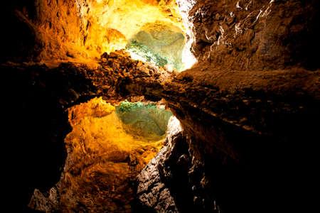 Underground lake with perfect reflection in Cueva de los Verdes. Lanzarote. Canary Islands. Spain Фото со стока