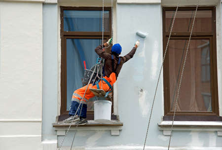 Repair and restoration of a facade of a building Фото со стока