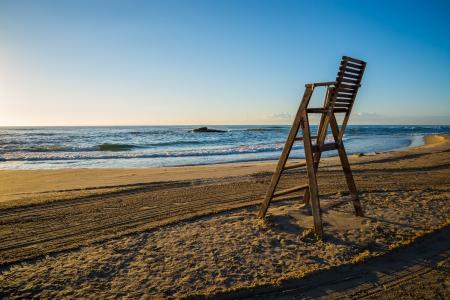 lifeguard chair on empty beach photo