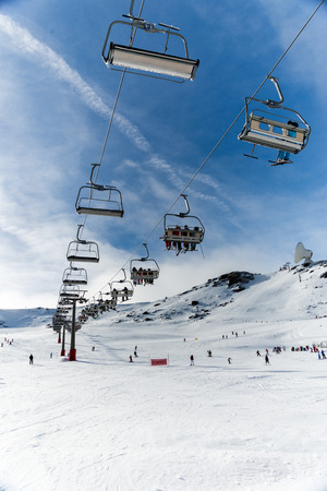 Chairlift in winter resort Stock Photo