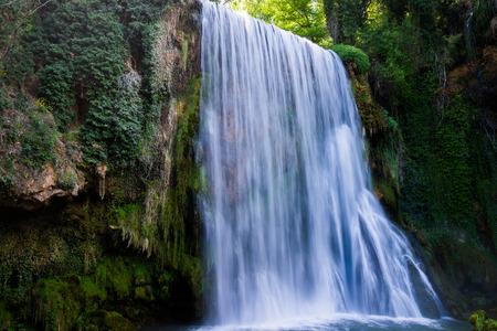 deluge: Waterfall from stone monastery Zaragoza Spain.