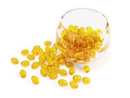 fish oil: Illustration of yellow  fish oil capsules in glass bowl with clipping path  Stock Photo