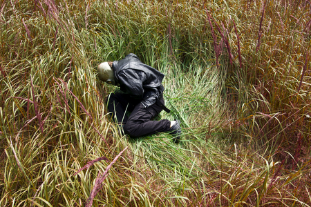 Man with gas mask in the grass