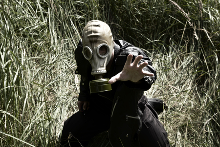 Man with gas mask in the grass Banco de Imagens