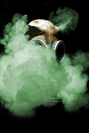 Close up of gas mask on black background. Stock Photo
