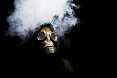 Portrait of man in gas mask on black background. 版權商用圖片