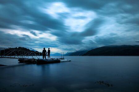 Happy couple enjoying the warm night in Norway