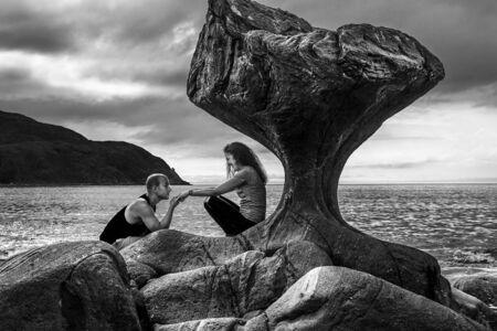 Happy couple enjoying time next to the Kannesteinen, Norway
