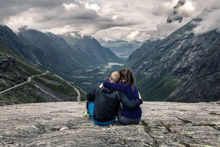 Young couple hiking in Trollstigen, Norway.