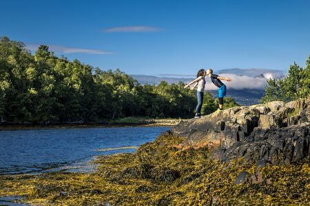 Happy and sporty couple enjoying the sunny day in Norway Banco de Imagens