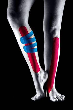 Medical taping for leg pain relief showed on young model.