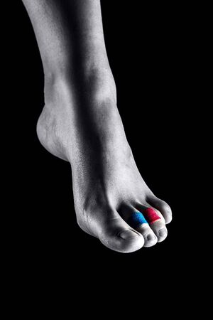Medical taping for hammer toe showed on young model.
