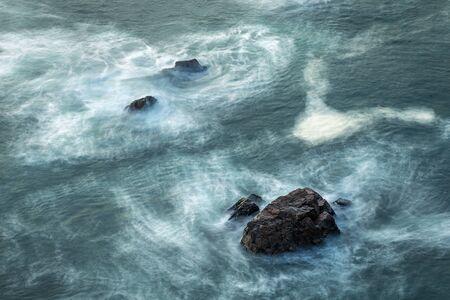Rock seaside shore with black round stone. Cabo da Roca, Portugal. Banco de Imagens