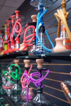 Colorful Hookah water pipes on shelf display