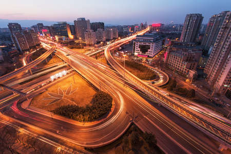 of movement: The light trails and modern building background in Beijing china.