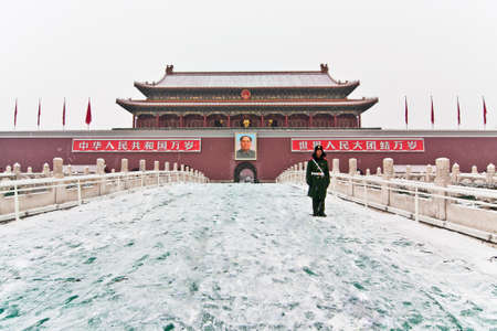 guarded: BEIJING - JANUARY20: Snowflakes were flying, a soldier stood on the Tiananmen rostrum in Beijing in January 20, 2013, china Guarded Chairman Mao Zedong in China is still worship.