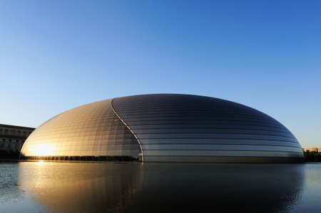 irradiation: BEIJING -JULY 5: China National Grand Theatre (National Performing Arts Center) morning, beautiful egg in the glow of the irradiation more beautiful - July 5, 2013 in Beijing, China