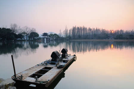 The sunset in Hangzhou West Lake photo
