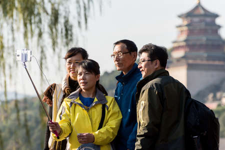 the summer palace: Summer Palace in Beijing tourists posed for pictures with the self-stick. Editorial