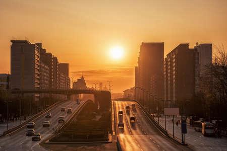 drive through: Beijing under the overpass Asaka. Commuters drive through Beijing overpass. Stock Photo