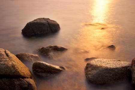 as far as the eye can see: Rocks beneath the setting sun