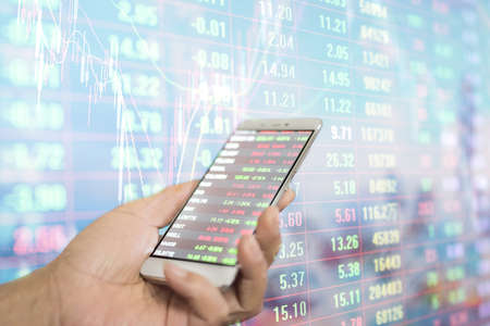 Blurred background image of stock trading using mobile phone