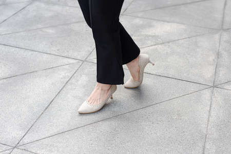 Close-up of walking feet in high heels