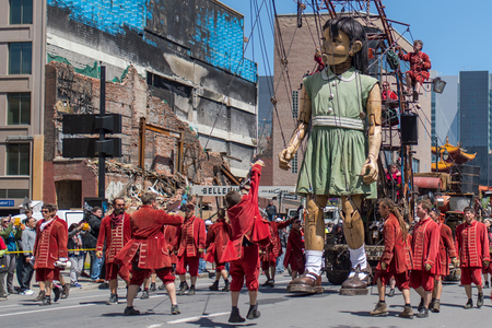 Montreal, Canada - May 20, 2017: The Little Girl-Giant presented by Royal de Luxe takes a walk on Viger Avenue to celebrate the 375th birthday of the city.