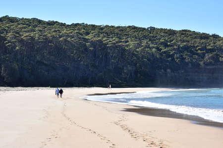 even: Couples Walking Along Beach