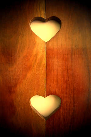 Heart shapes carved in wood.