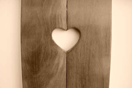 Heart shape carved in wood. Stock Photo