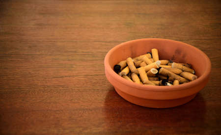 An ash tray full of cigarettes