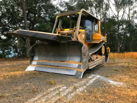 Bulldozer with tree pusher attachment