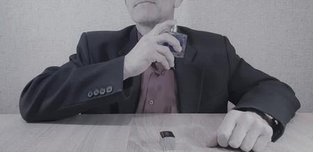 The Adult man uses perfume