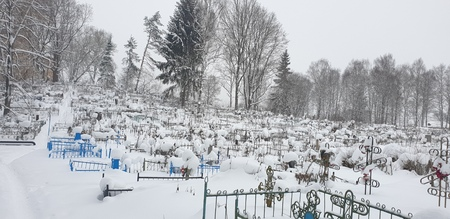 The Cemetery in winter. Cemetery covered with snow in winter.