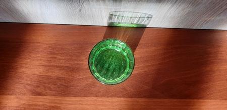 . Green carbonated lemonade. Green drink in a glass beaker.