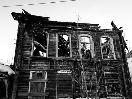 the burnt house. Burnt wooden house. House after the fire.