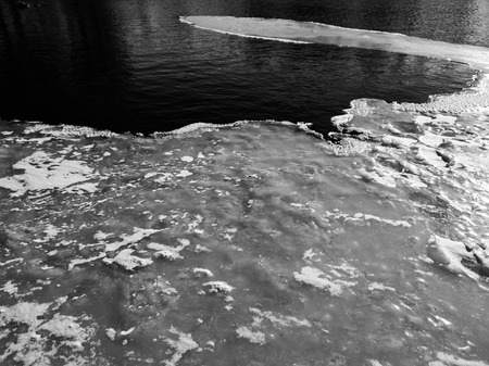 The melting ice on the river close up. Ice on the river in the spring. Imagens