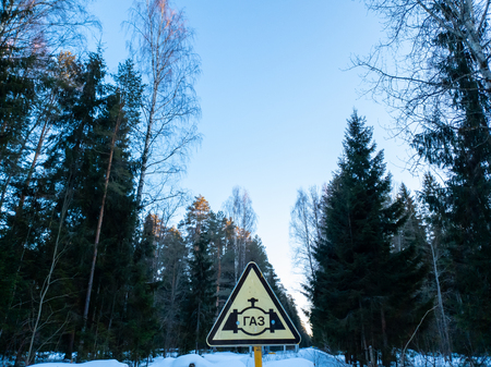 The Gas sign close up. Triangular sign GAS. Natural gas. Gas in the forest. Banco de Imagens
