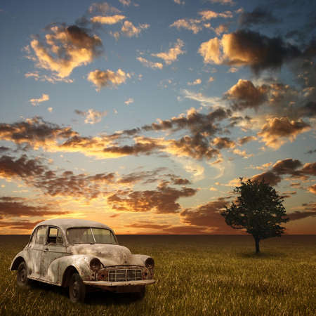 broken car: An Old Abandoned Car with Sunset