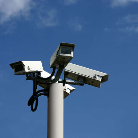 A Bunch of Security Cameras with Blue Sky Stock Photo - 5612135