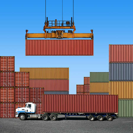 container port: Stack of freight containers at the docks with Truck Stock Photo