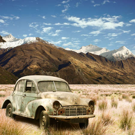 An Old Car in a Mountain Landscape photo